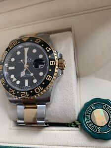 ROLEX GMT MASTER II YELLOW GOLD / SS LIKE NEW