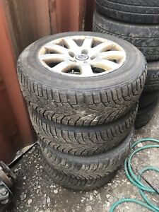 """Volks Audi 15"""" mags with tires good for a winter 100$"""