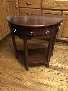 "Half round accent table 28.5"" tall x 27.75"" wide x 14"" deep"