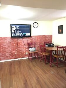 $350/Week 2bdms furnished private basement suite Wifi&utilities