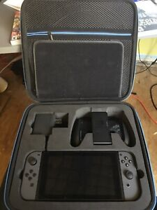 Nintendo Switch + Hard Shell Travelling Case + 6 Games