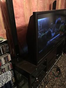 "56"" DLP Toshiba HD TV, stand and bookshelf DVD player"