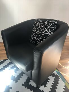 Black faux- leather tub chair