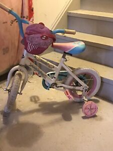 Girls bike with training wheels and purse