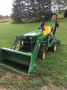 John Deere 1025R sub compact with backhoe, loader and box blade