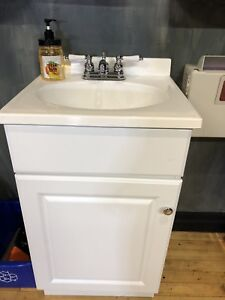 Two bathroom vanity with sink and faucet