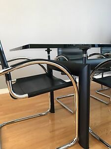 Le Courboursier glass dining table and chairs