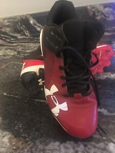 Under Armour size 5 baseball cleats.