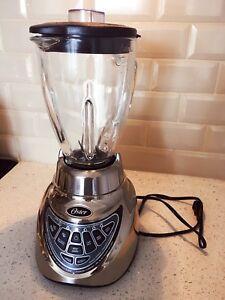 Oster blender & free 12 mission jars