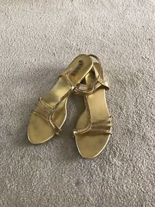 Women's pair of gold Lord's ankle strap sandals, size 40