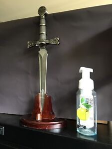 Dagger letter opener with stand.