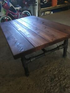 Custom rustic reclaimed pipe table