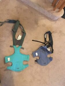 2 snugli/evenflo Baby carriers.