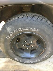 (4) 225/75/15  A/T2 mud snow tires on Jeep rims
