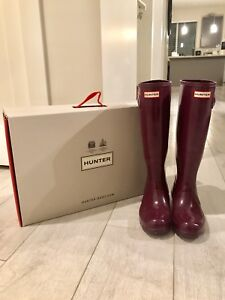 Pair of shiny Purple Hunter rain boots with box