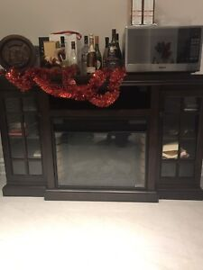 Real solid oak TV stand with built in fireplace and shelves