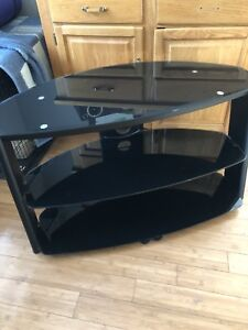 TV Stand can be used corner or flat along wall