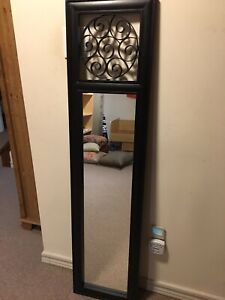 Black painted frame mirror with decorative inset