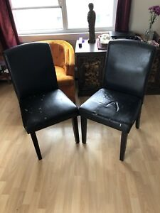 Two faux leather high back kitchen chairs