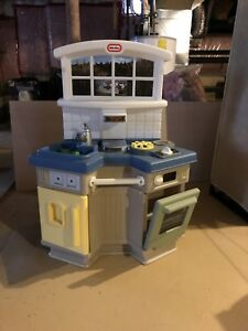 Little Tikes play toy kitchen and wooden table with two chairs