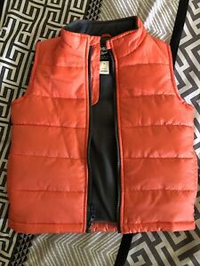 Orange Oshkosh vest