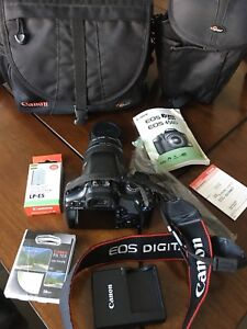 Canon Rebel xsi w/add battery, filter and two bags