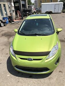 Ford fiesta 2012 ** A/C, Toi ouvrant , Mags **