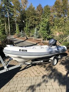 12.6' Highfield Inflatable boat with 20 horse Yamaha  outboard