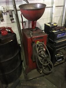 Oil drain catch with pump