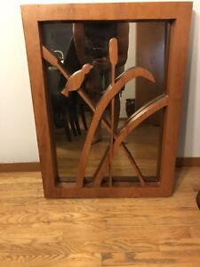 Hand carved wooden mirror