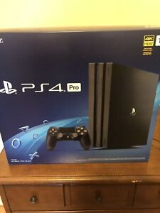 PS4 PRO WITH CONTROLLER AND 2 GAMES