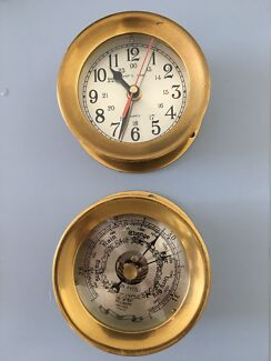 Pair of brass barometer and clock