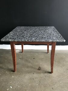 Two identical marble top side tables