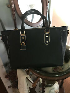 Large black purse. Lots of room inside. Excellent condition.