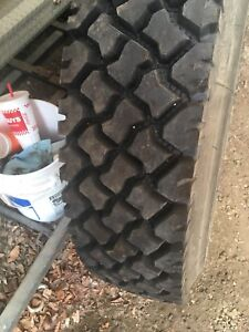 11R22.5 deep drive traction tires on hub mount wheels