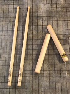 Drumsticks, wood claves, and toy instruments
