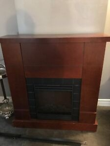 Electric fireplace with wood mantle