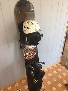 K2 snowboard with bindings and boots and helmet