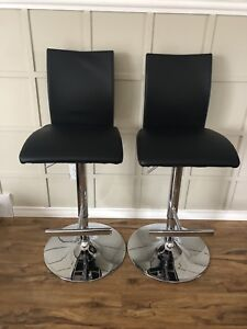 Two Adjustable Island / bar stools ($90 for both)