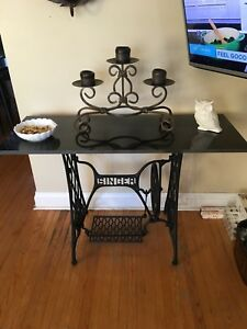 Singer sewing machine base.  Granite top