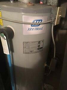 Oil fired hot water tank and burner