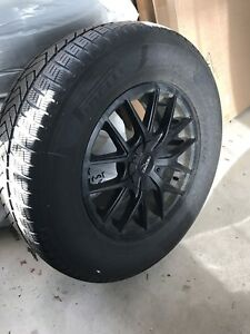 4 Pirelli Winter Tires on Black Touren Rims with Sensors