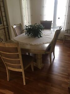 Immaculate dining room table and China cabinets for sale