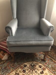 2 blue wing chairs