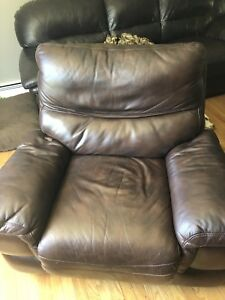 Two brown leather recliners.