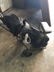 Golf clubs with cart and bag