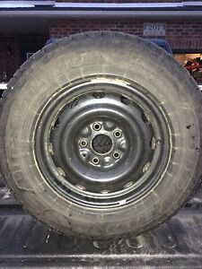 Set of  4 Goodyear Ultra Grip snow tires and rims