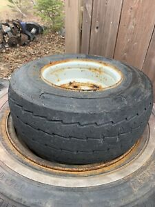 Trailer rim and tire.