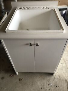 Laundry/utility sink with cabinet combo