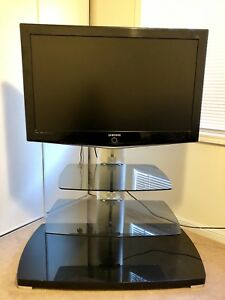 Samsung TV with Glass TV stand with shelves